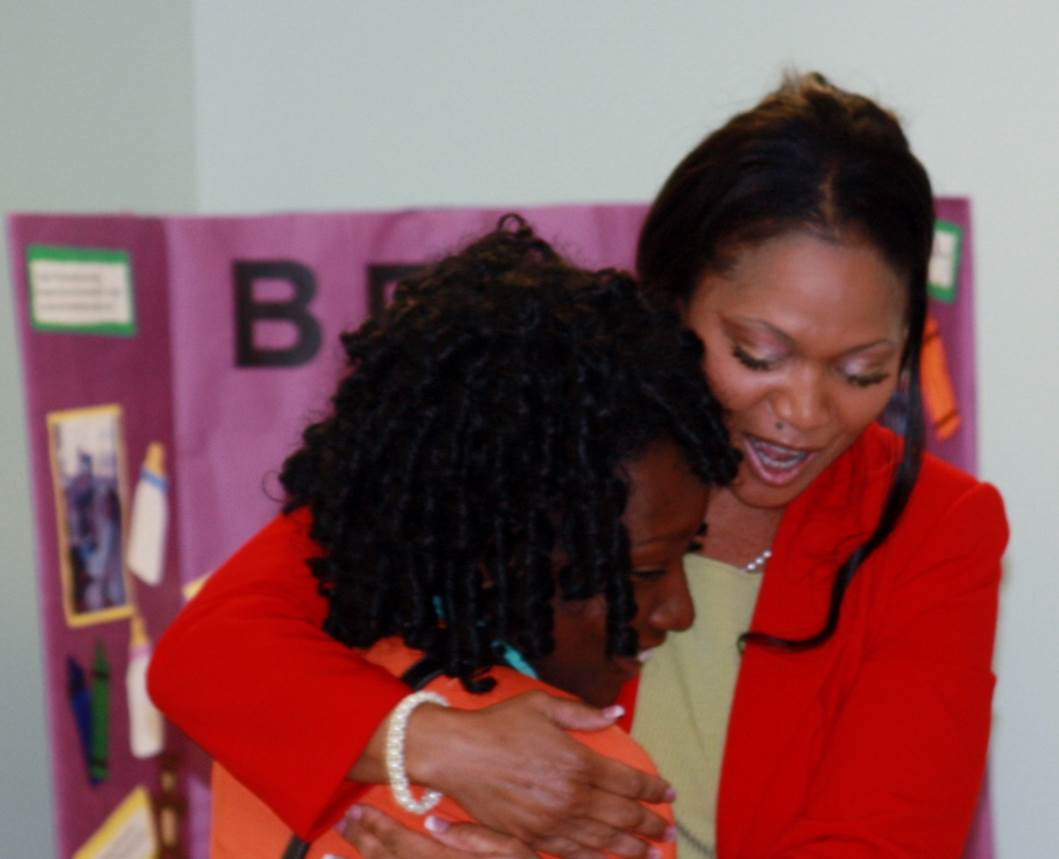 Dr. Bush hugs a future STEM professional
